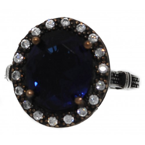 Ring round silver and blue sapphire and zircons