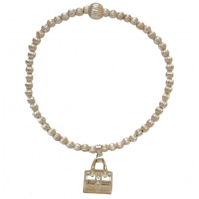 Bracelet  in silver balls and pendant bag