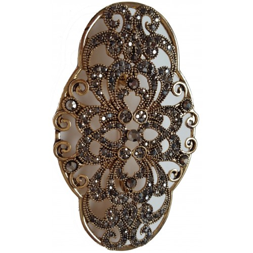 Brooch in gold metal and shiny gray stras