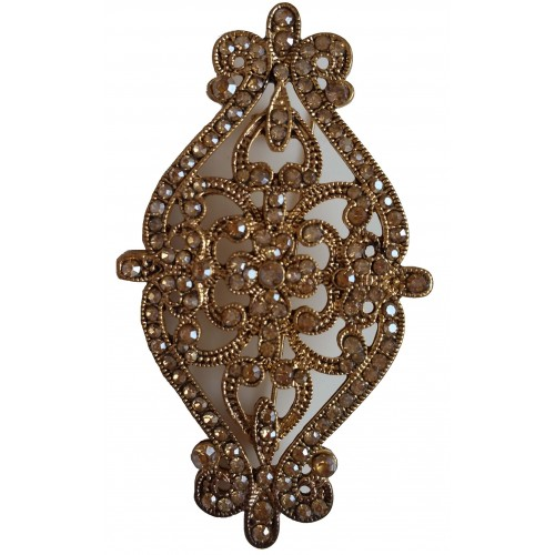 Brooche oval in gold metal and shiny gold stras.