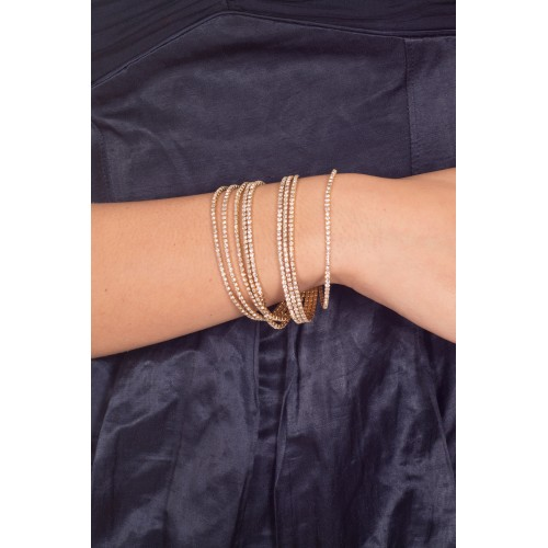 Costume cuff bracelet in gold color and stras threads