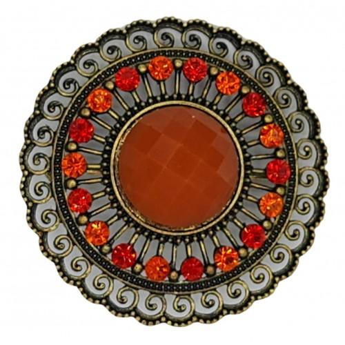 Broche redondo en metal dorado y piedra de resina