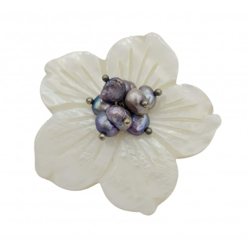 Mother-of-pearl flower brooch with lilac centerpiece