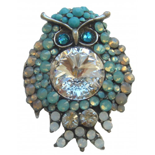 Brooch owl in light blue with shiny stras.